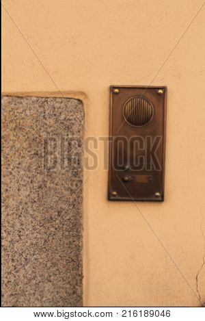 Old intercom on home exterior. Voice speacker