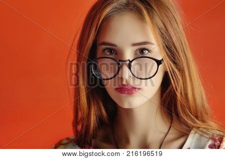 Portrait Of A Caucasian Female Young Model  In Glasses In An Ivory Dress.