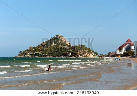 Beautiful seascape with a mountain Khao Takiab with a 20-meter Buddha statue and several temples. Hua Hin, Thailand