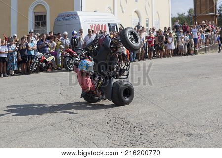 Verkhovazhye, Vologda region, Russia - August 10, 2013: Dangerous stunt on an ATV by Thomas Kalinin
