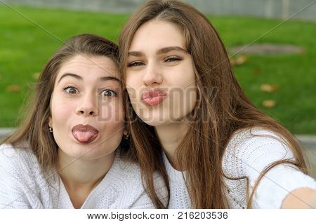 Portrait Of Two Girls Who Have Fun Laughing