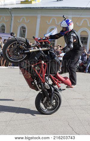 Verkhovazhye, Vologda region, Russia - August 10, 2013: Stunts on a motorcycle by Alexei Kalinin