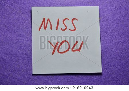 word miss you on  an  abstract blue background