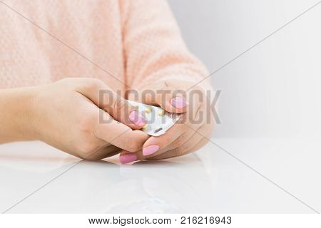 Woman hand holding contraceptive pill or birth control pill
