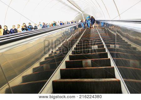 Petersburg, Russia - June 30, 2017: People On An Escalator In The Metro.