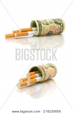 cigarettes and money isolated on white background. vertical photo.