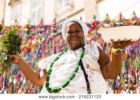 Candomble priestess wearing traditional clothes at Bonfim Church in Salvador, Bahia, Brazil