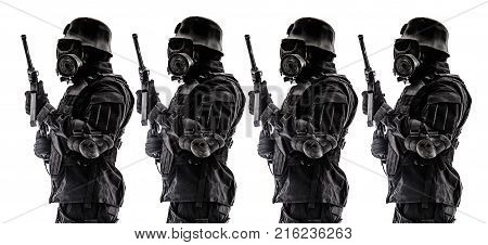 Line of futuristic nazi soldier sentinel gas mask and steel helmet with schmeisser handgun isolated on white studio shot standing to attention profile