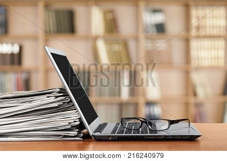 Isolated newspaper laptop global communications the media information medium social issues