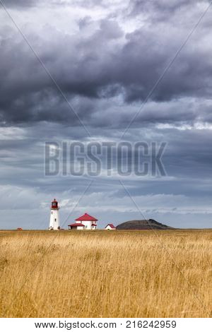 The Anse a la Cabane, or Millerand lighthouse of Havre Aubert, in Iles de la Madeleine, or the Magdalen Islands, of Canada. This is the tallest and oldest working ighthouse of the archipelago.
