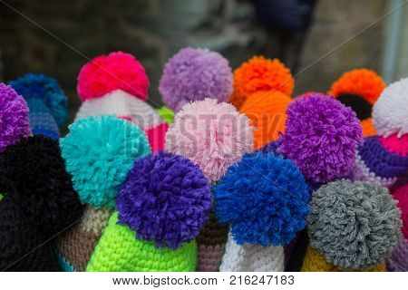close up of colored pom poms with background