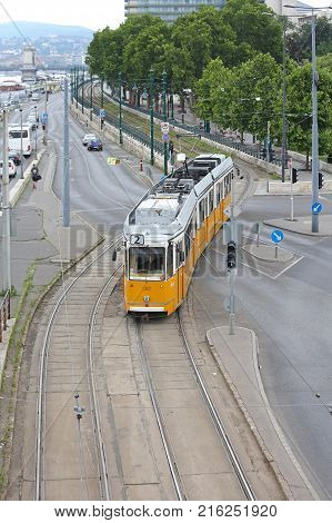 BUDAPEST HUNGARY - JULY 13 2015: Tram Number Two Crossing Street Public Transportation Network in Budapest Hungary.
