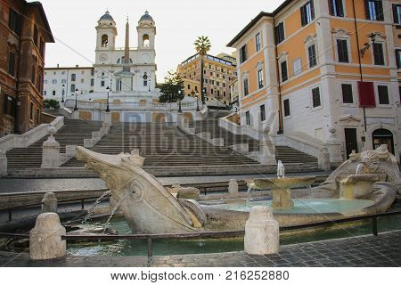 Fontana della Barcaccia in Piazza di Spagna with Spanish Steps in background. Rome Italy