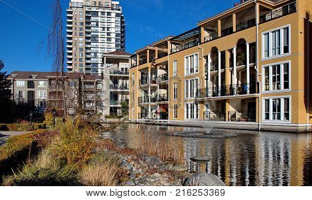 Residential District in Downtown of New Westminster pond and fountain in the yard of a residential complex