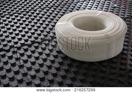 Radiant underfloor heating insulation boards with flexible tubing prepared
