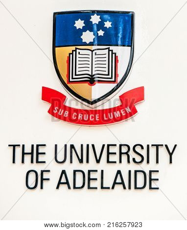 Adelaide SA Australia - November 20 2009: Closeup of the identification sign of the University of Adelaide with slogan and coat of arms against white background.