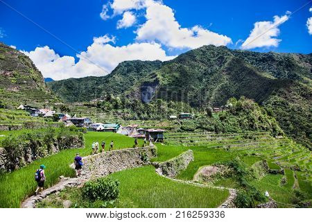 BATAD, PHILIPPINES-MARCH 31, 2016: Tourists hiking at 2000-year old Batad Rice Terraces on March 31, 2106, Central Luzon on Philipines, Southeast Asia