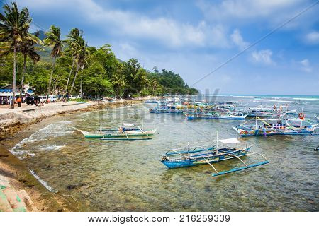 SABANG, PHILIPPINES-MARCH 27, 2016, Longtail boats line from Sabang to cave entranceof Puerto Princesa subterranean underground river, one of the 7 New Wonders of Nature, on March 27, 2016.Palawan