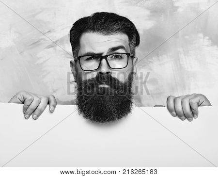 Bearded Man With Serious Face In Glasses On Colorful Background