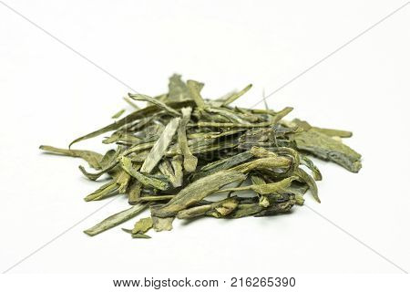 A stack of delicious green tea leaves with tips on a white background