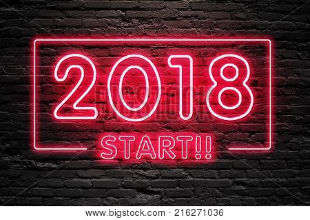 GET READY FOR 2018 NEW YEAR concept. 2018 START text fluorescent Neon tube Sign on dark brick wall. Front view. Can be used for online banner ads or background. night moment.