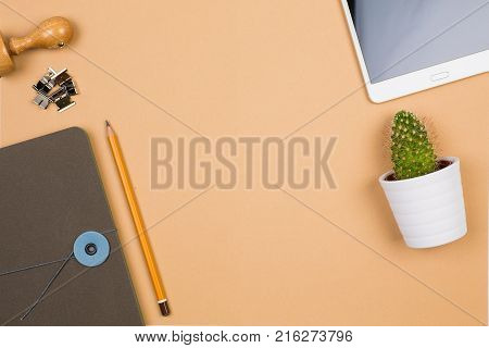 flat photo with office equipment stamp pencil and notebook orange wall