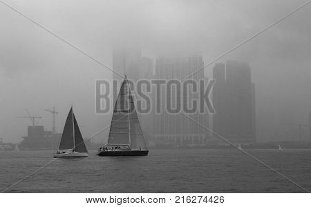 Sail Boats in Hong Kong Harbour and City in the background