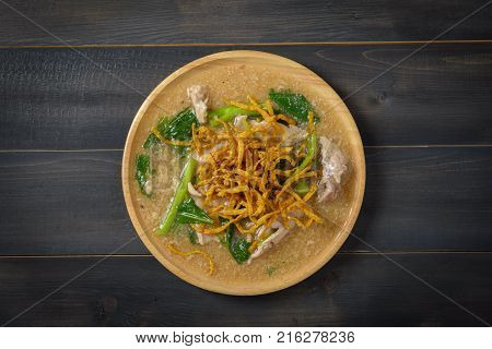 Noodles in Thick Gravy (Rad Na) on the wooden table Thai local food Top view