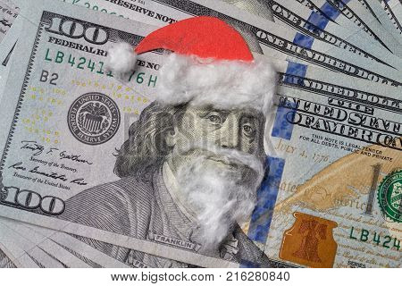 Benjamin Franklin in a Santa Claus hat with beard on a bill. Christmas decorations