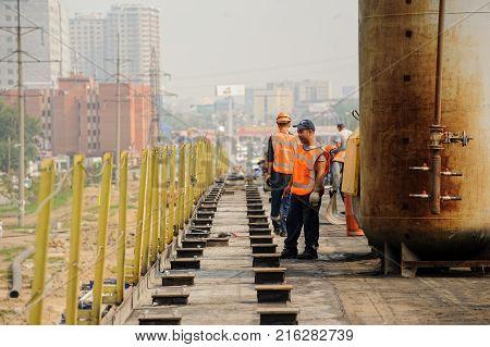 Tyumen Russia - July 31 2013: JSC Mostostroy-11. Bridge construction on Melnikayte street through Shirotnaya street