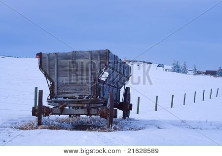 Old Antique Wagon in snow covered field