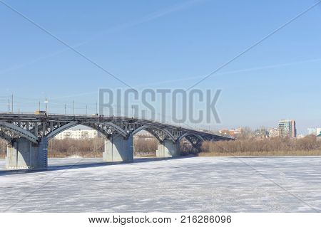 Nizhny Novgorod, Russia. - March 14.2017. Kanavinsky Bridge over the Oka River. View from the high bank side. Spring melting ice will soon open and an ice drift will begin.