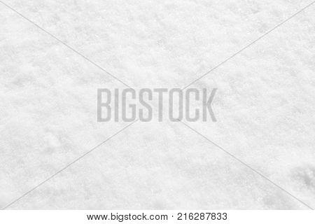 Fresh white textured snow powder close-up background