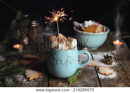 hot chocolate with marshmallows and a Sparkler