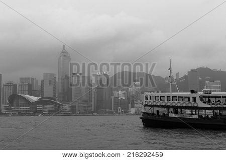 HONG KONG HARBOUR, HONG KONG - NOV 12, 2017: A ferrry boat crosses the harbour between Kowloon and Hong Kong city.