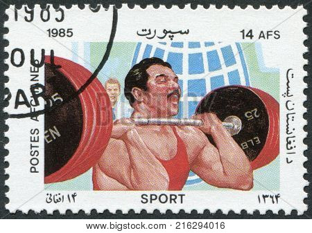 AFGHANISTAN - CIRCA 1985: A stamp printed in the Afghanistan, is shown Weight lifting, circa 1985