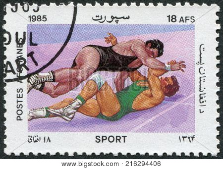 AFGHANISTAN - CIRCA 1985: A stamp printed in the Afghanistan, is shown Wrestling, circa 1985