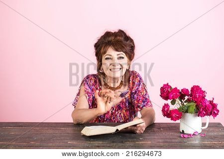 Pension and retirement old age. Old woman reading book with glasses at flowers. happy old lady or grandmother. Writer and poet granny read fairytale. Teacher or professor education teachers day. poster