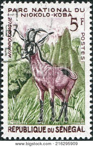 SENEGAL - CIRCA 1960: A stamp printed in Senegal shows Roan antelope (Hippotragus equinus), Niokolo-Koba National Park, circa 1960