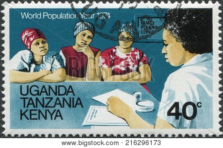 EAST AFRICAN COMMUNITY - CIRCA 1974: A stamp printed in East African Community, is dedicated to World Population Year, is shown Advice on family planning, circa 1974