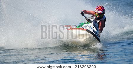 WYBOSTON, BEDFORDSHIRE, ENGLAND -  APRIL 09, 2017: Jet Ski cornering at speed creating at lot of spray.