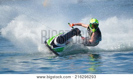 Jet Ski competitor cornering at speed creating at lot of spray. poster
