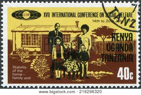 EAST AFRICAN COMMUNITY - CIRCA 1974: A stamp printed in East African Community, dedicated to the International Conference on Social Welfare, shows a family of five persons, circa 1974