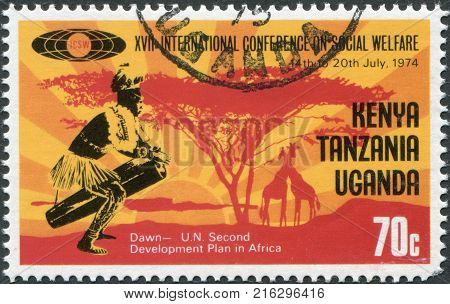 EAST AFRICAN COMMUNITY - CIRCA 1974: A stamp printed in East African Community, dedicated to the International Conference on Social Welfare, shows a drummer and a sunset, circa 1974