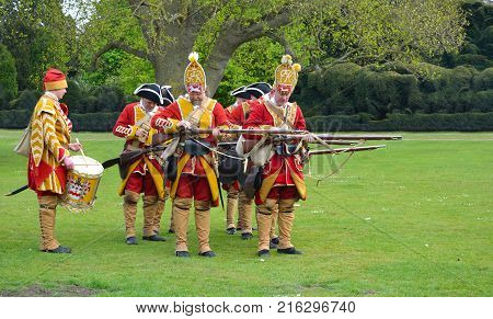 SAFFRON WALDEN, ESSEX, ENGLAND - MAY 01, 2017:  The Redcoats of  Pulteneys  Regiment loading their Muskets.