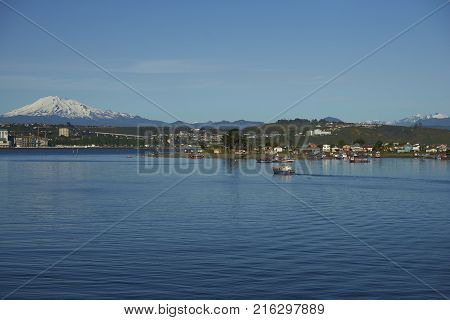 Puerto Montt, Chile - November 10, 2017: Fishing boat in the busy port of Puerto Montt in Southern Chile