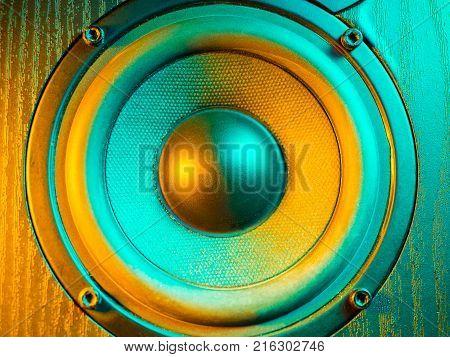 Close up details of loudspeaker woofer and tweeter driver. Colorful led light.