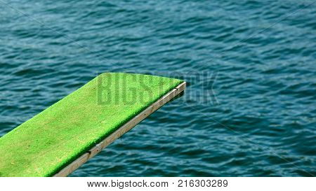 Summer vacation and dangerous sport. View of diving board. Springboard to dive at water.