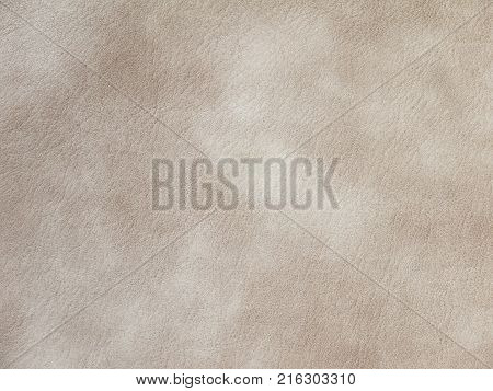 Beige textured polyurethane faux leather material swatch