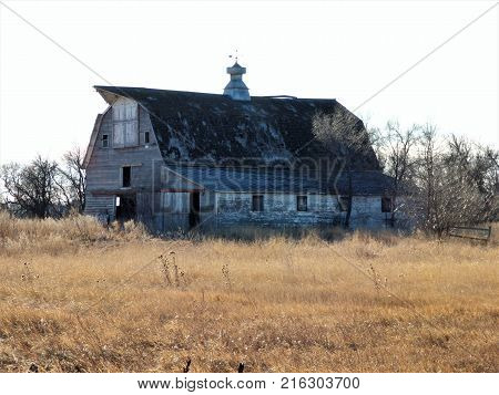 An old abandoned barn on a abandoned farmstead.